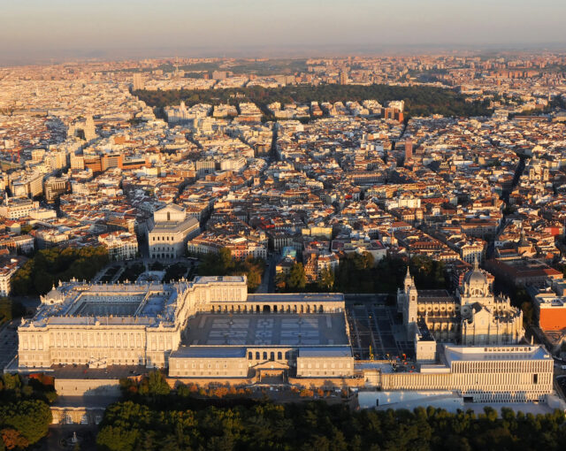Aerial view of Madrid, with the Royal Palace, the Almudena Cathedral and the Royal Collections Museum in the foreground.