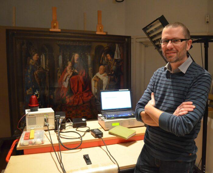 Geert van der Snickt at the MA-XRF scanner during the scanning of Jan van Eyck's<em> Madonna with Canon Joris van der Paele</em> in the Groeningemuseum, Bruges.