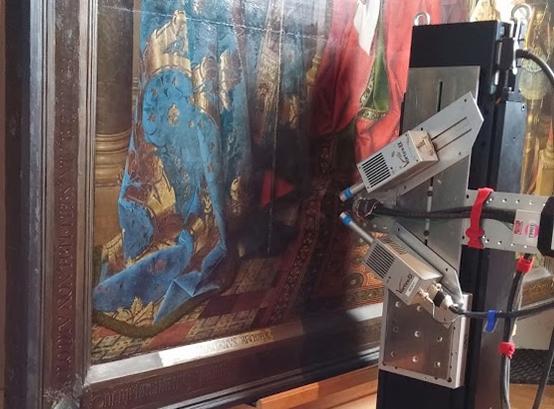 Detail of the MA-XRF scanner aimed at Jan van Eyck's <em>Van der Paele Madonna</em> in the Groeningemuseum, Bruges.