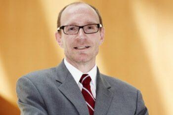 Photo of Dr. Lloyd DeWitt