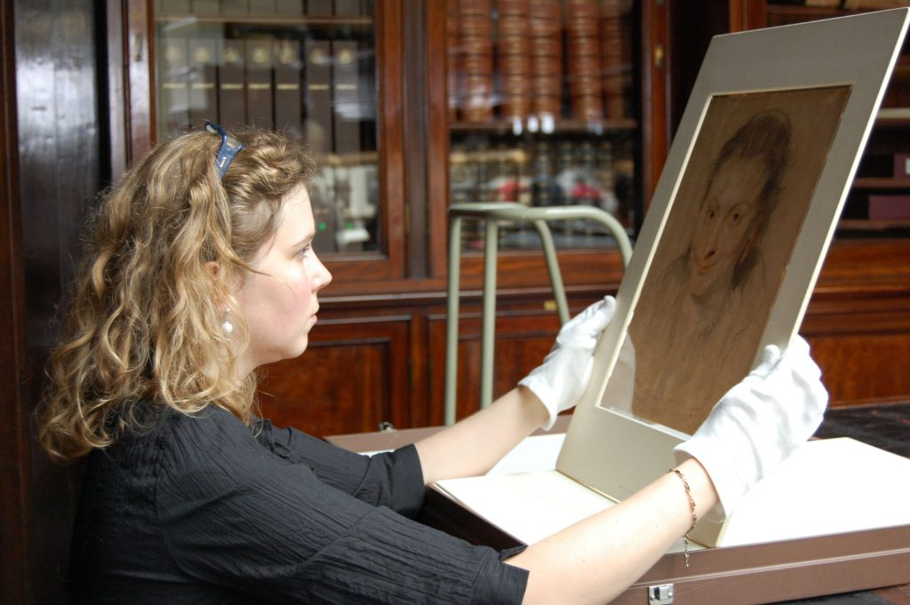 An Van Camp studying the Portrait of Isabella Brant by Rubens