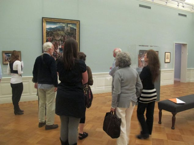 Jan Piet Filedt Kok leads the group through the Lucas van Leyden exhibition