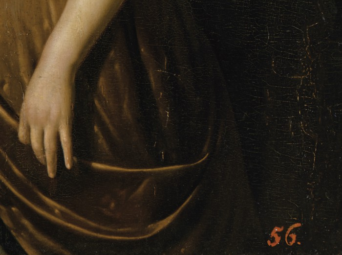 Detail of the inventory number of Stanisław August's collection on <em>Portrait of a Young Lady with a Rose</em> by Pieter Cornelisz. van Slingeland, (1640-1691) painted in 1675<br>Royal Łazienki Museum, Warsaw