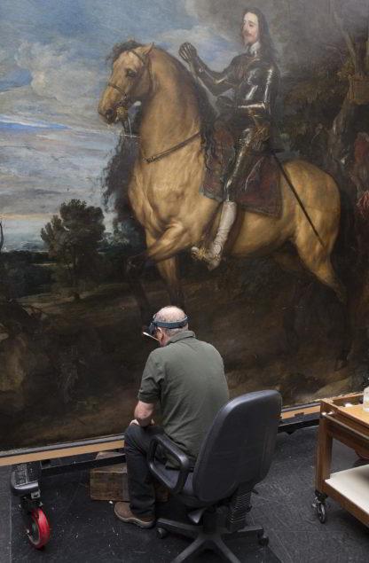 Paul Ackroyd restoring Anthony van Dyck's <em>Equestrian Portrait of Charles I</em> Photo: The National Gallery, London